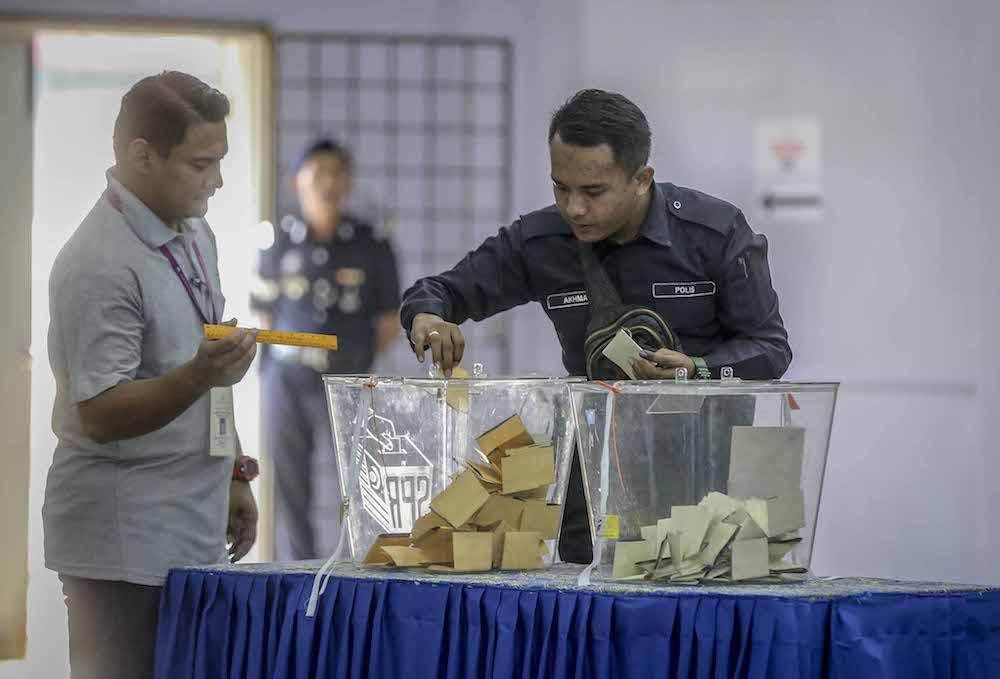 王建民指出,大選成績顯示,軍警票都轉投希盟了。 - Firdaus Latif攝-
